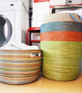 Gorgeous laundry baskets. Made in West Africa. Funds from the baskets are used for educating girls in the country where the baskets are woven.