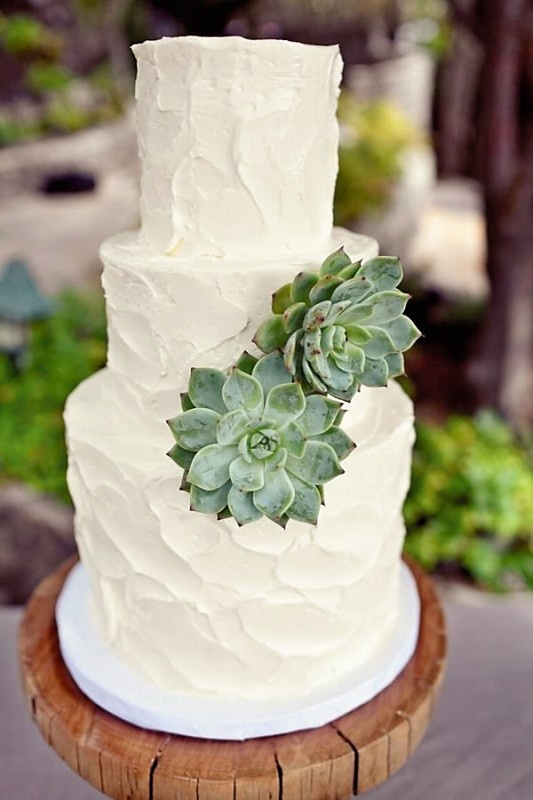 Buttercream or Whipped cream frosting Wedding cake with flowers