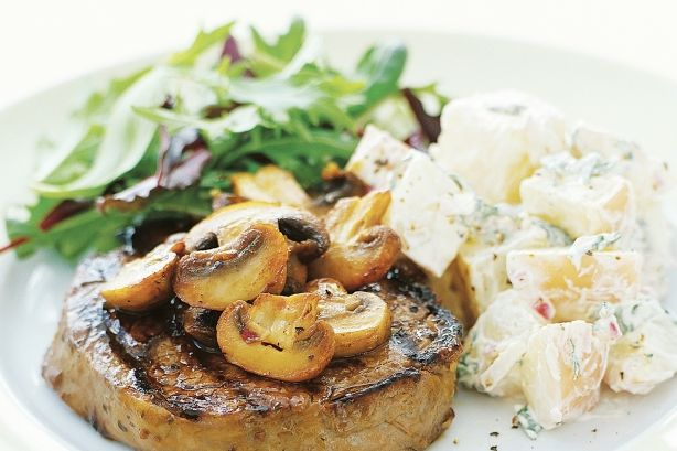 Red wine and garlic marinated steaks with warm potato salad main image