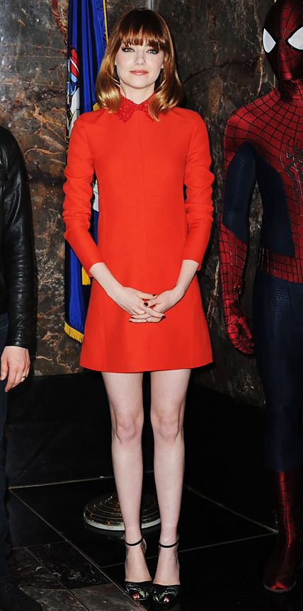 Emma Stone was red-hot at the Empire State Building, selecting a red long-sleeve Valentino shift with an embellished collar, with black ankle-strap Valentino sandals.