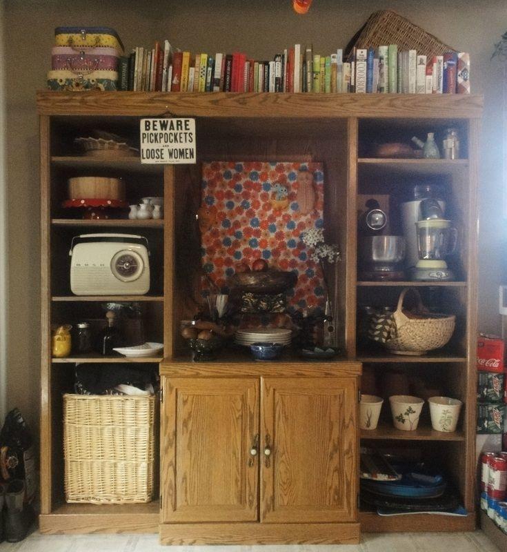 Kitchen appliance storage in old entertainment unit via Pinterest