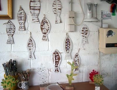 Fish hanging from a wall.