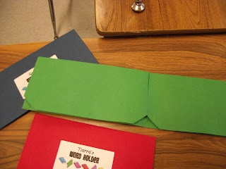 Cut off the folder pockets in a folder and secure with a velcro dot. Use to store Sight Word cards.