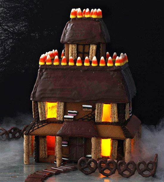 Amaze guests at your Halloween get-together with this gingerbread Halloween house! Get step-by-step instructions here: http://www.bhg.com/halloween/recipes/gingerbread-halloween-house/