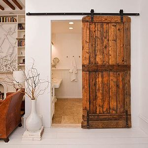 ARTICLE: Reclaimed Doors - Design's Entryway Into Yesterday | Image Source: The Dove Cote | CLICK LINK TO READ... http://carlaaston.com/designed/reclaimed-door-design-entryway-to-yesterday