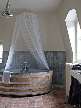 Wine-barrel bathtub. Outside or inside? Definitely surrounded by different decor.