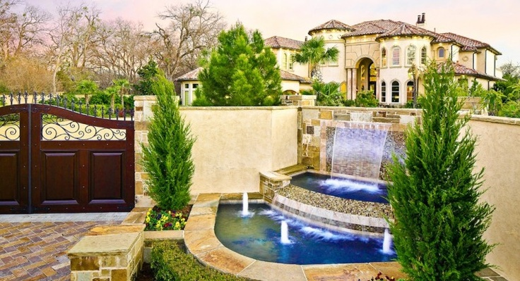 Who wouldn't want a home with a waterfall to greet you as you drive up? Amazing curb appeal! (6644 Spring Valley Road, Dallas)