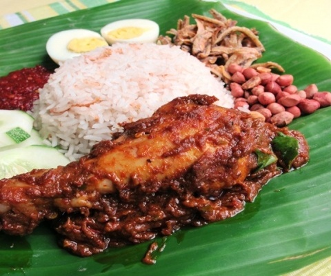 Nasi Lemak with Rendang chicken - wrapped in banana leaf. Cucumber ...