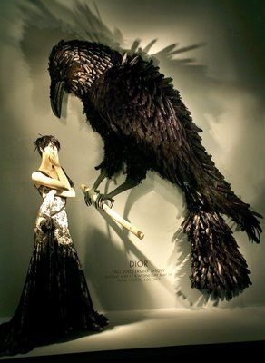 Best part for me, besides the giant crow, is the use of lighting to create drama. The downside is the dress almost gets lost in the display.   Bergdorf Goodman