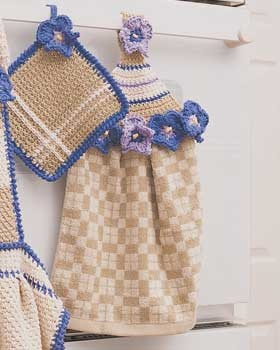 ... crocheted daisies and elegant square pot holder shown in Bernat