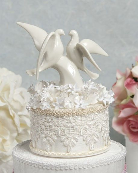 We had Lladro doves on our wedding cake, & then it became the tradition for both of my husband's brothers when they married too