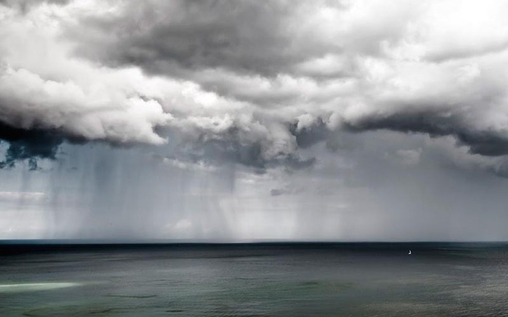 LONE SAILBOAT AT SEA IN GERMANY   Photograph by Patrick Lienin for National Geographic     In this incredible photograph by Patrick Lienin, we see a lone sailbaot at sea as a rainstorm looms in the distance. The photograph was submitted to the 2011 National Geographic