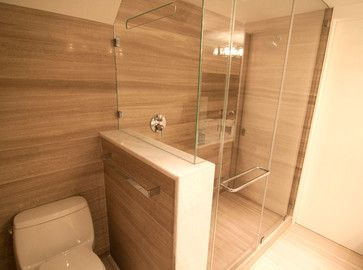 Amazing Modern Bathroom With Floor To Ceiling Marble Tiles Stock Photo