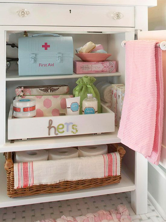 organized bathroom cabinet. love the lunch box turned first aid kit.