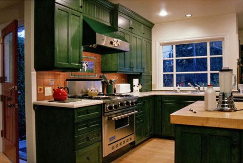 Green cabinets? with glass in cement countertops? and an awesome