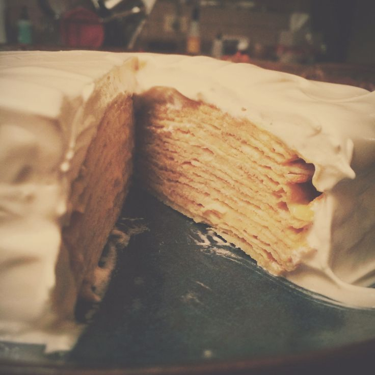 Meyer lemon curd crepe cake with Italian meringue icing. Made with ...