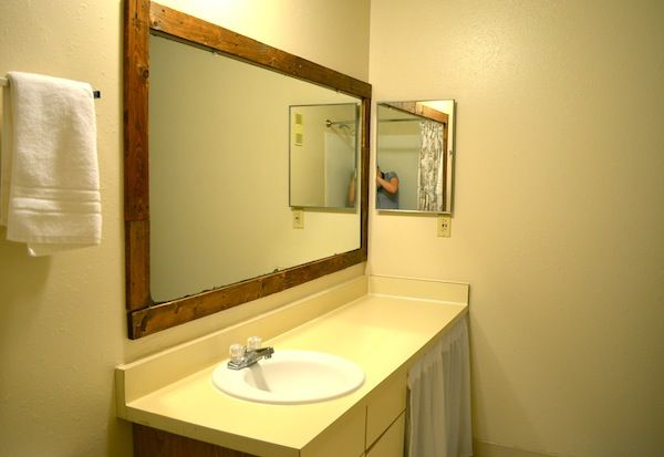 framing a bathroom mirror with pallets