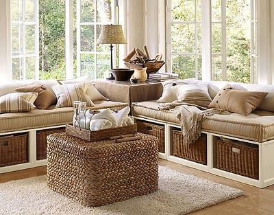 Use a great big lidded basket as a coffee table.  Have done this in the family room.