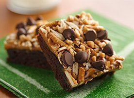Top fudgy brownies with a warm gooey caramel layer, chocolate chips ...