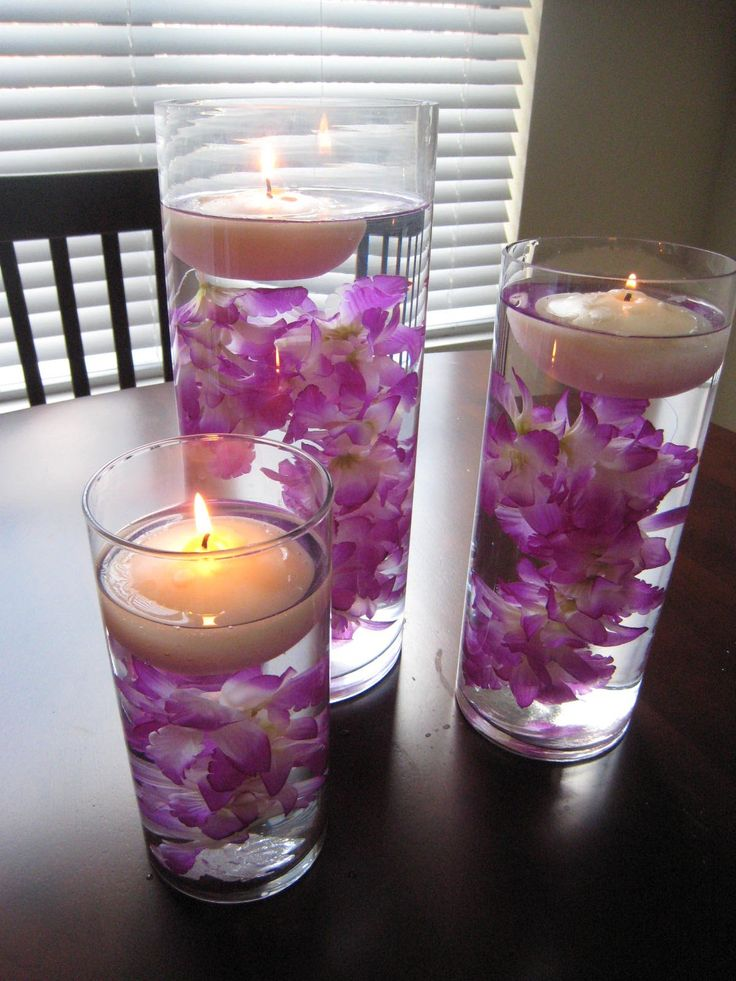 water, flower, and candle center pieces