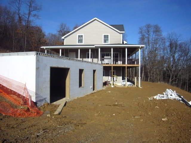 Structural garage for sloping lot dream home pinterest for Building a garage on a sloped lot