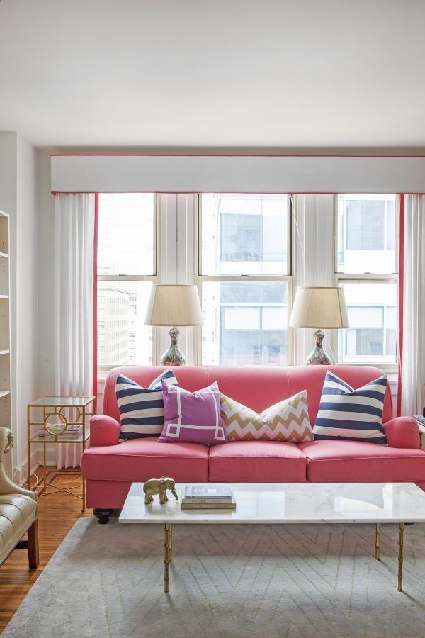 pink couch, patterned pillows, pink accents, gold accents