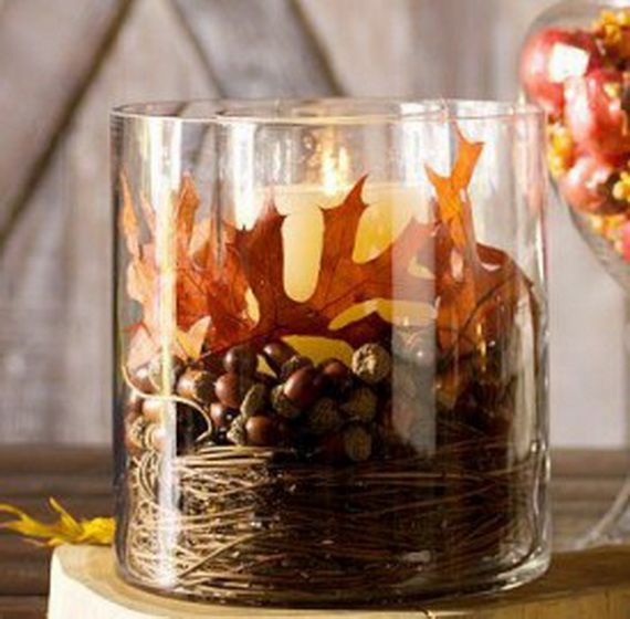 Candle with acorns and leaves round it http://www.familyholiday.net/fall-decor-crafts-easy-fall-leaf-art-projects