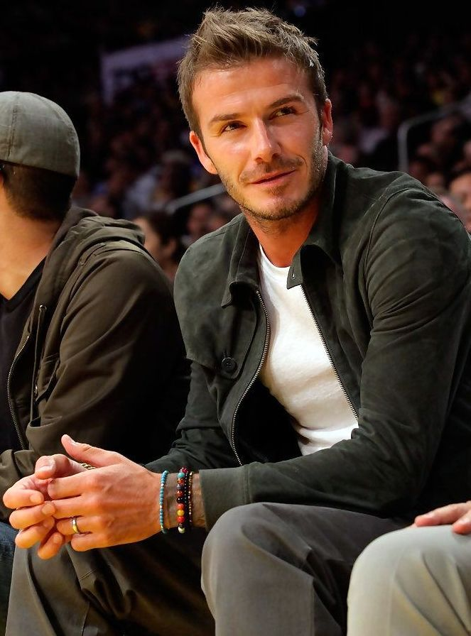 David Beckham- simple white undershirt, grey piece pants, black zip-up jacket + braided-beaded  cord bands
