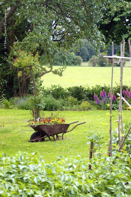 Wheelbarrow Garden   Content in a Cottage