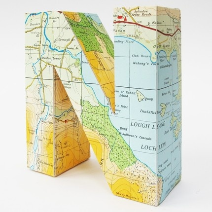 3d letter covered with vintage map