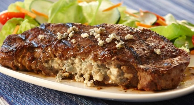 ... in Lawry's® Balsamic Herb Marinade and stuffing with blue cheese