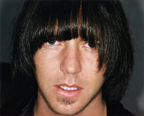 """Johnny Ramone: """"My Hair fell out in huge clumps. I got a wig made that cost four thousand dollars. I wore it one time and I felt ridiculous. I gave it to Eddie Vedder. One night he was hanging out with Theo Epstein. He called me the next day and said, """"I was drunk last night and took photos with the wig on."""" He sent them to me and they were hysterical. Eddie and Theo, drinking and wearing the wig. The photos were worth the four grand."""""""