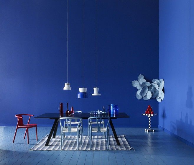 blue dining room with white and red accent