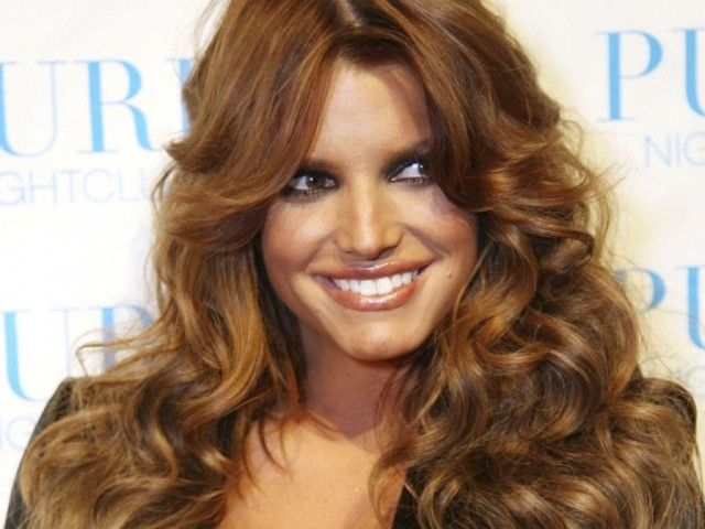 an earthier, more natural hair color. Usually with her blonde hair ...