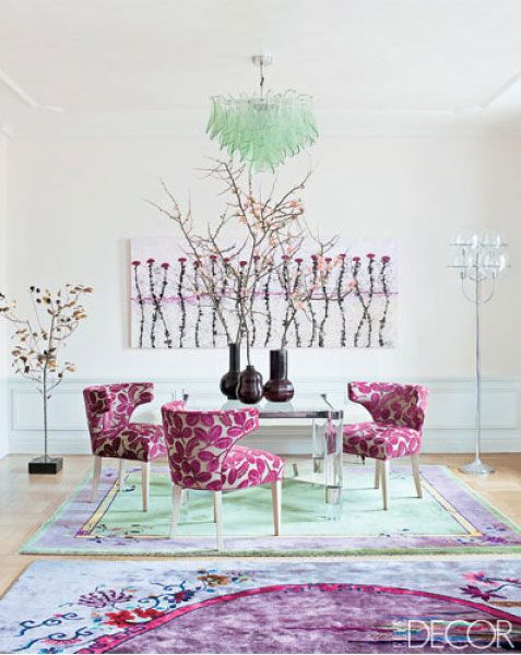 Floral upholstery and art in watercolor shades elevate this games area.