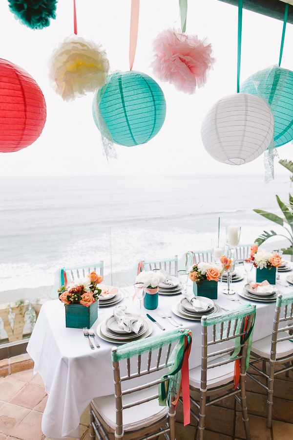paper lanterns, photo by Steve Cowell Photo http://ruffledblog.com/encinitas-beach-wedding #weddingideas #paperlanterns