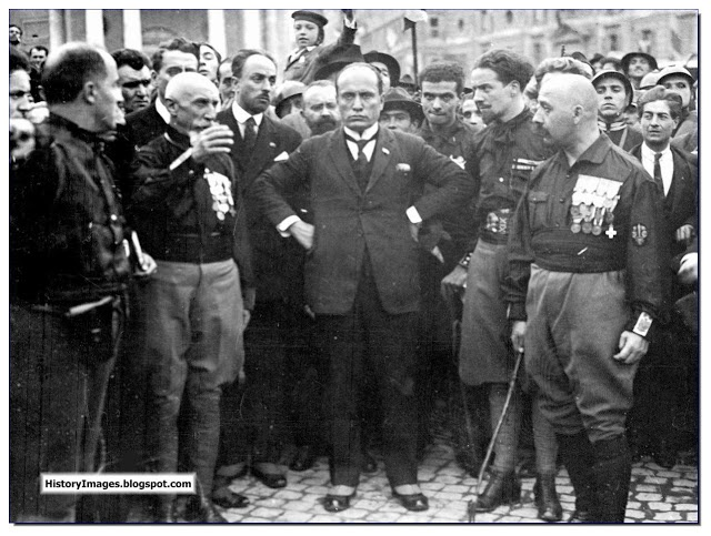 October 28, 1922. The March to Rome. Mussolini seizes power in Italy. Here he is seen with his followers.