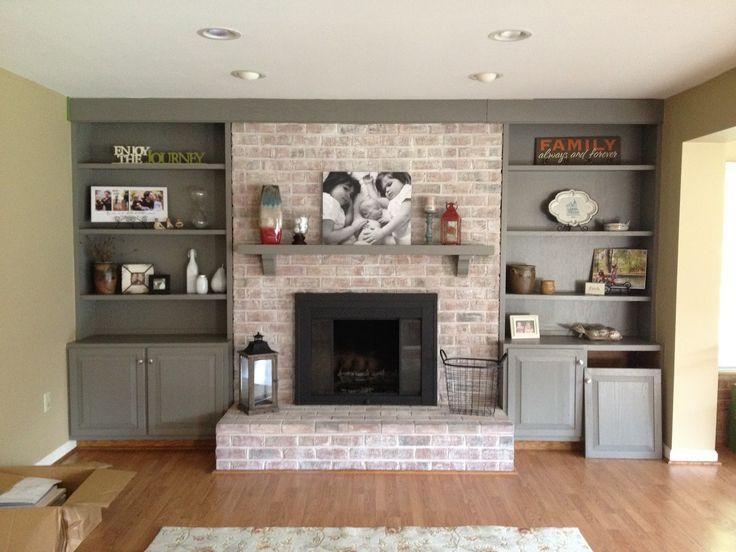 white washed fireplace and side shelves home ideas