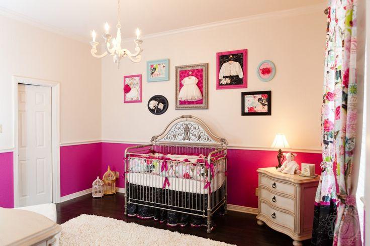 Love the idea of framed vintage baby clothes behind a vibrant fabric! #nursery #walldecor #vintage