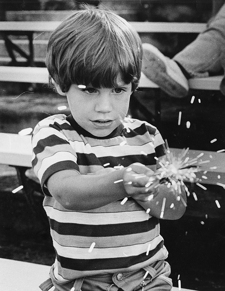 Daniel Arthur plays with a sparkler in Victory Stadium on July 4, 1979.