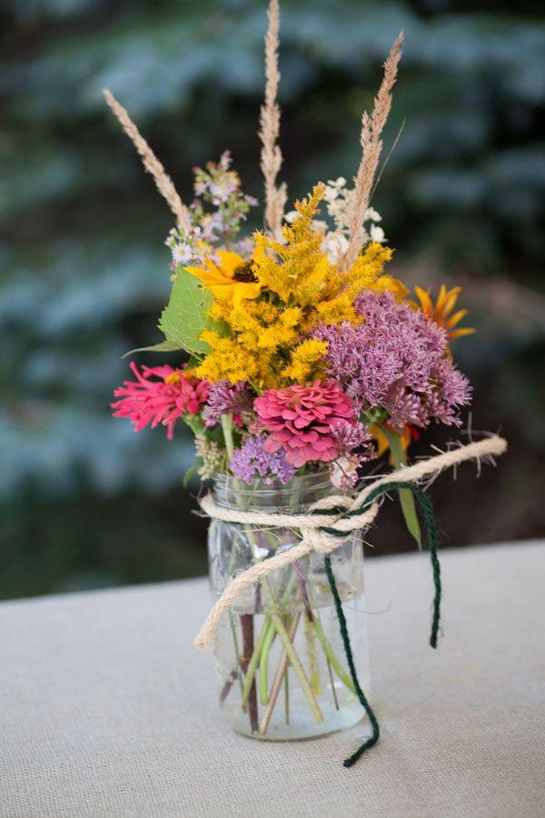 wildflower centerpieces in mason jars yellow purple pink. Black Bedroom Furniture Sets. Home Design Ideas