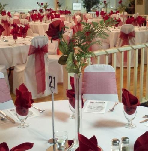 Quot vase with single red rose rosebud centrepiece
