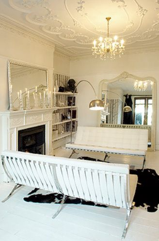 pretty white antique mirrors in a modern living room