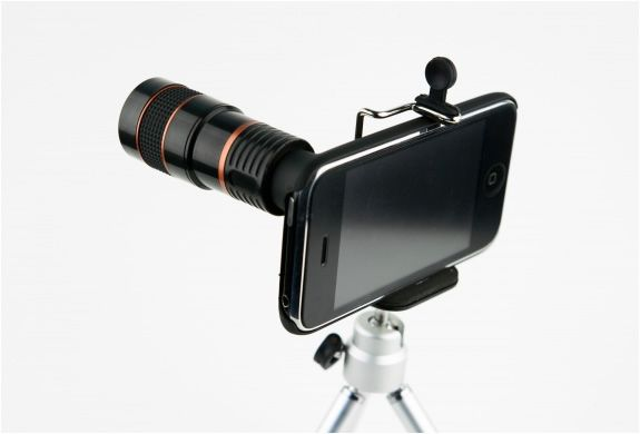 """IPHONE TELEPHOTO LENS  Photojojo keeps surprising us with their weird and wonderful stuff, we have featured here the very cool """"Fisheye, Macro, and Wide Angle Camera Phone Lenses"""", we now present you we another fun camera lens """"The iPhone Telephoto Lens"""", it takes iPhoneography to the next level with an 8X telephoto zoom. Each lens comes with a case, mini tripod and cleaning cloth."""