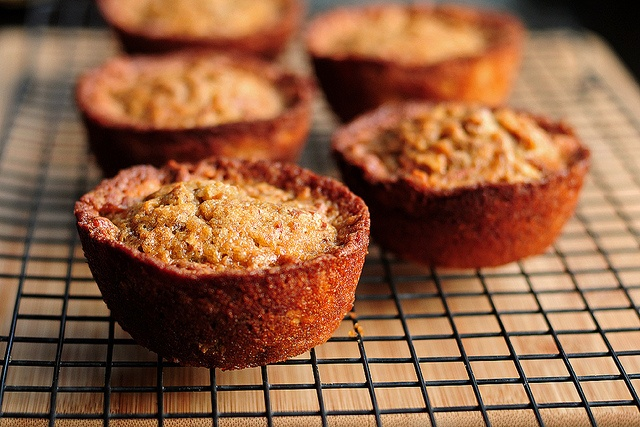 Pioneer Woman's pecan pie muffins -- deeelish but be sure to oil AND ...