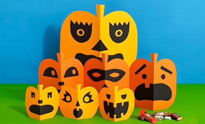 These simple pumpkins inspired by paper-chain dolls let kids create a string of festive faces.