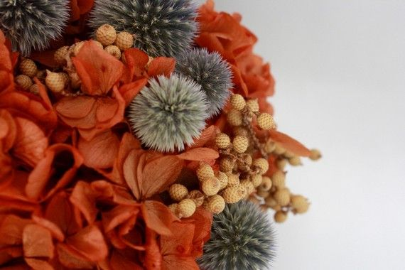 A unique bouquet with orange and gray