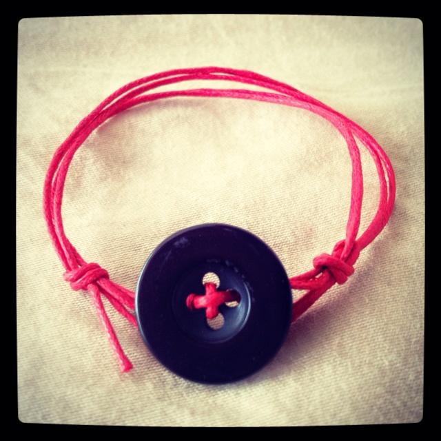 I'm getting obsessed with making string bracelets.   Button + cotton cord.