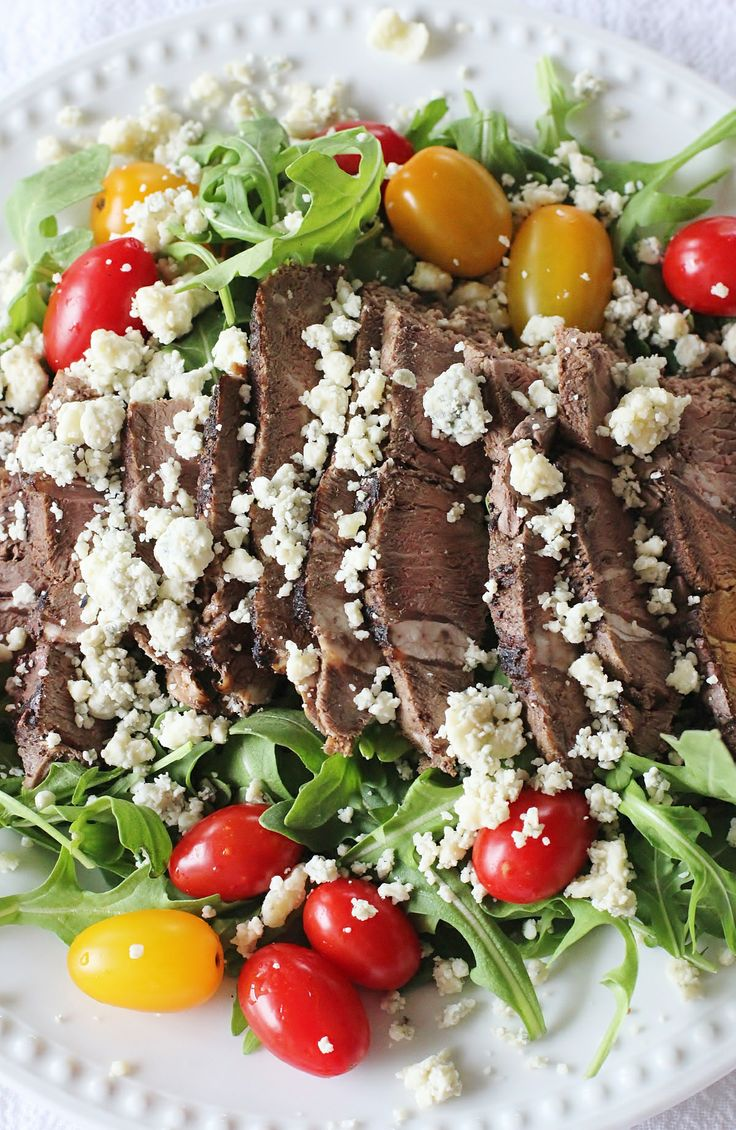 Sirloin Steak and Arugula Salad. Thinly sliced cold sirloin steak sits ...