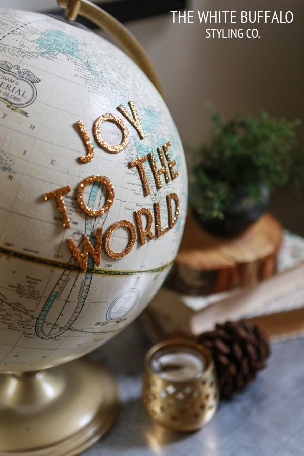 Decor Inspiration - Love this idea, use self-adhesive letters to create a joyous message (now I need to find a globe) View More: http://kimdeloachphoto.pass.us/larkblog